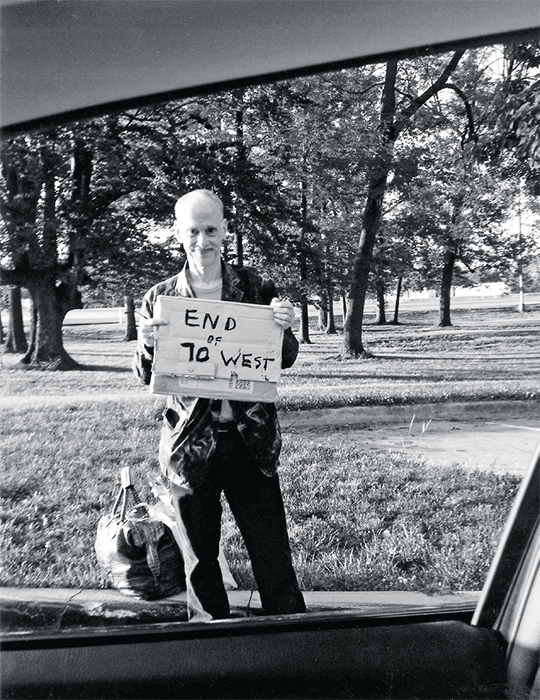 *John Waters hitchhiking, May 2012.* Photo: Shauta Marsh.