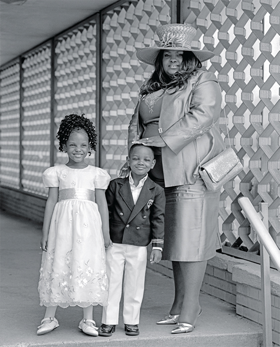 "Bruce Weber, Grace, Immanuel & April Archer at Perfecting Church, Detroit, Michigan, 2006, gelatin silver print, 24 × 20""."
