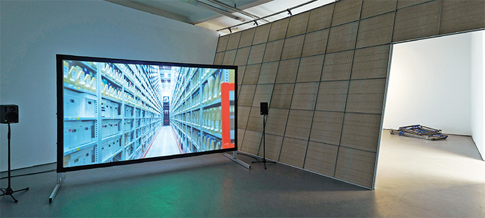 "View of ""Dennis McNulty,"" 2014. From left: The Archivist, 2014; The Wall, 2014; Portable Framework, 2010."
