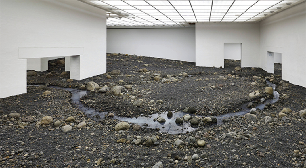 Olafur Eliasson, Riverbed, 2014, blue basalt, water. Installation view.
