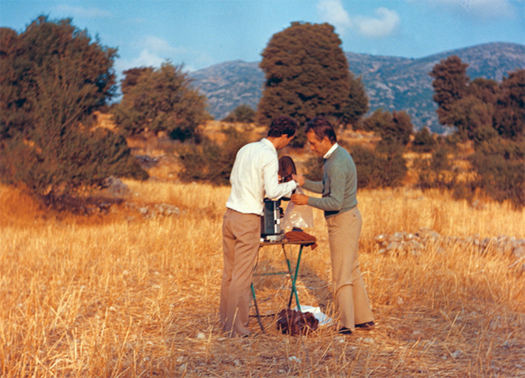 Robert Beavers and Gregory J. Markopoulos prepare for a  screening at the Temenos, Lyssaraia, Greece, 1980. Photo: Tassos Dambergis.