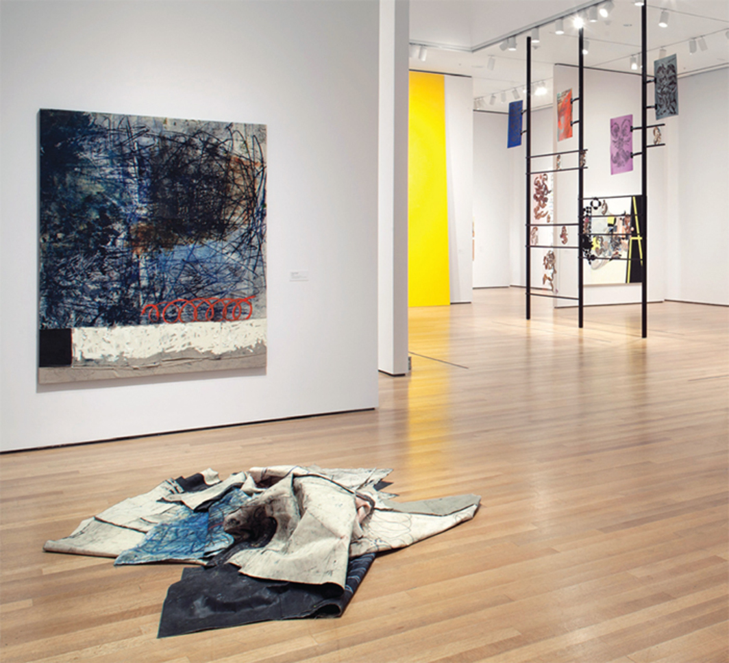 "View of ""The Forever Now: Contemporary Painting in an Atemporal World,"" 2014–15. Floor, foreground: Paintings by Oscar Murillo, 2012–14. Left wall: Oscar Murillo, 1/2, 2014. Background: Kerstin Brätsch, Sigi's Erben (Agate Psychics), 2012. Photo: John Wronn."