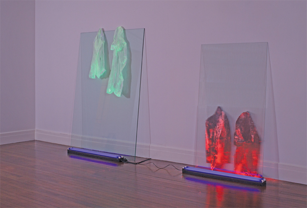 "Keith Sonnier, Ju-Ju, 1970, cheesecloth, black lights, glass, 7' 4"" × 12' 6"" × 1' 4"". © Artists Rights Society (ARS), New York/ADAGP, Paris."