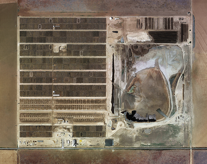 "Mishka Henner, Wrangler Feedyard, Tulia, Texas, 2013, ink-jet print, 59 × 73 1/4"". From the series ""Feedlots,"" 2012–13."