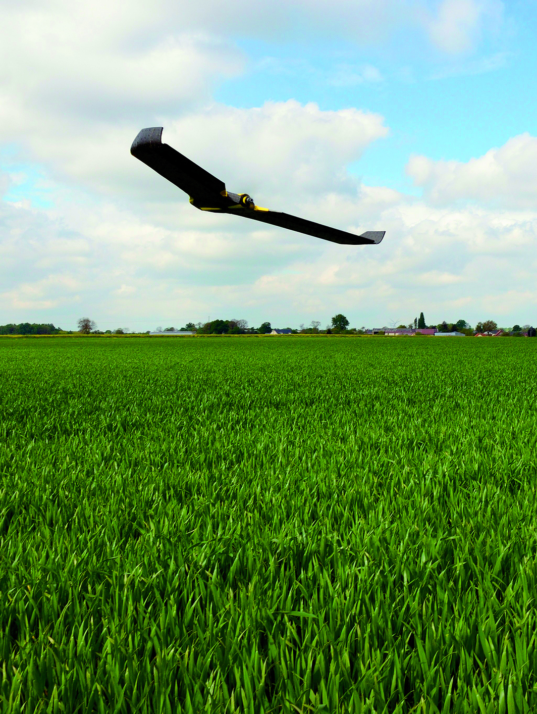 GPS-guided drone surveying crops and measuring the supply of nitrogen necessary to improve productivity, Caulières, France, May 6, 2014. Photo: Denis Charlet/AFP/Getty Images.