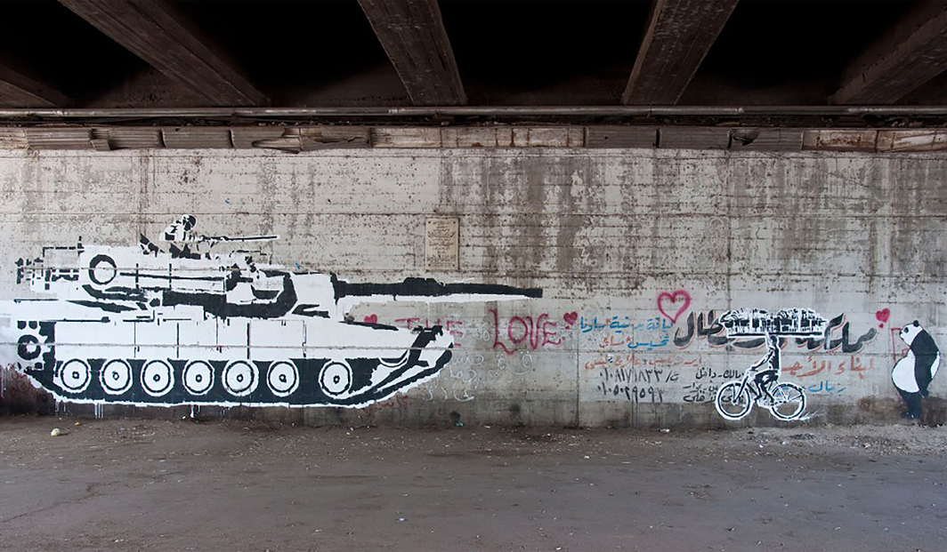 Ganzeer, Tank vs. Bread-Biker, Cairo, 2011. Photo: JoAnna Pollonais.