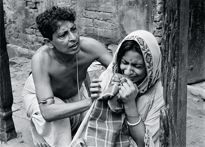 Satyajit Ray, Pather Panchali (Song of the Little Road), 1955, 35 mm, black-and-white, sound, 125 minutes. Apu's father, Harihar (Kanu Banerjee), and mother, Sarbajaya (Karuna Banerjee).