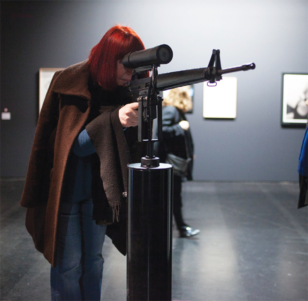 Lynn Hershman Leeson, America's Finest, 1994, M16 rifle, webcam, original software. Installation view.