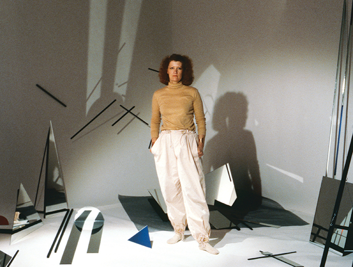 "Barbara Kasten at her exhibition ""Centric 2: Barbara Kasten, Installation/Photographs,"" 1982, Art Museum and Galleries, California State University, Long Beach."