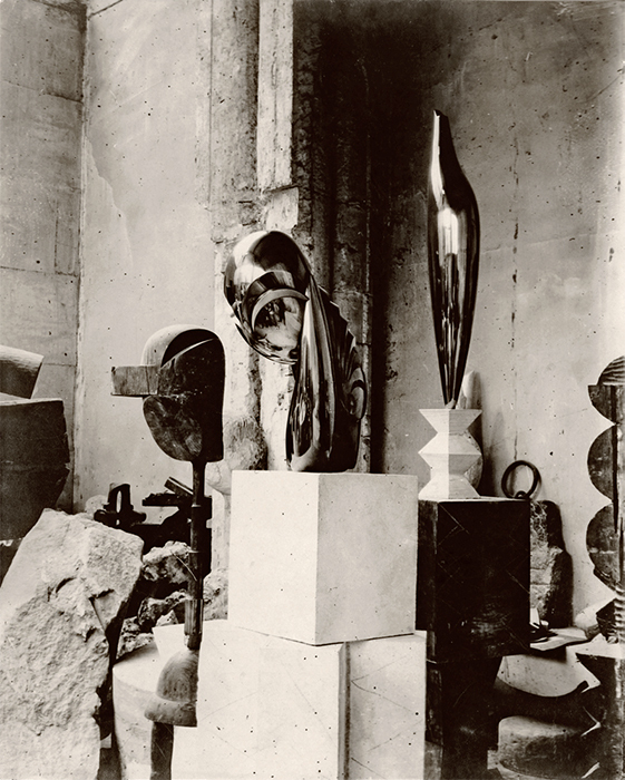 "Constantin Brancusi, View of the Studio: Plato, Mademoiselle Pogany II, and Golden Bird, ca. 1920, gelatin silver print, 11 3/4 × 9 1/2"". From ""In the Studio: Paintings""/""In the Studio: Photographs."" © Artists Rights Society (ARS), New York/ADAGP, Paris."