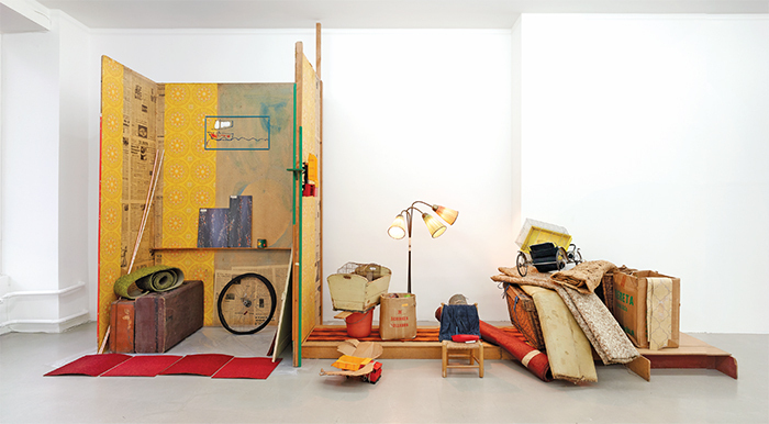 "Vlassis Caniaris, Interieur, 1974, mixed media, 6' 6"" × 17' × 4' 7""."