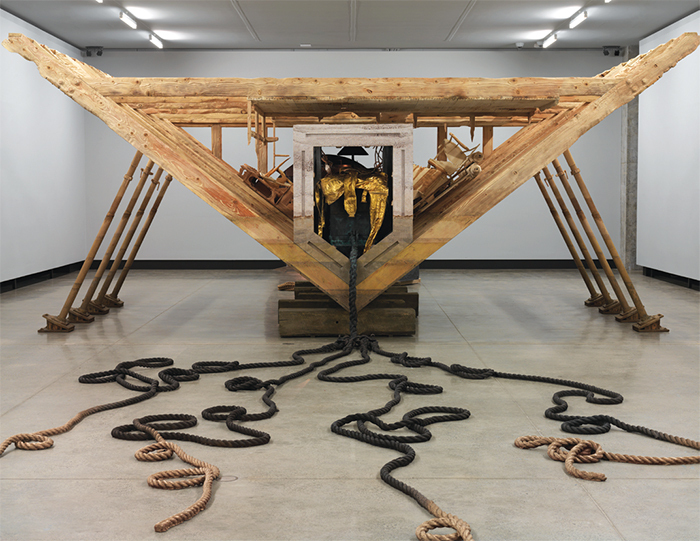 Matthew Barney, Boat of Ra, 2014, wood, resin-bonded sand, steel, furniture, cast bronze, gold-plated bronze, 11 × 50 × 24'.