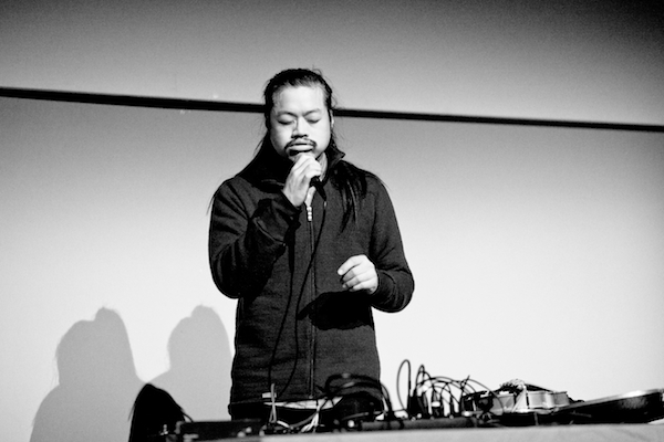 C. Spencer Yeh performing at the Museum of Modern Art in Warsaw, 2014. Photo: Bartosz Stawiarski.