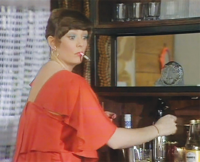 "*_Play for Today_, 1977*, still from a TV show on BBC. Season 8, episode 3, ""Abigail's Party."" Beverly (Alison Steadman)."