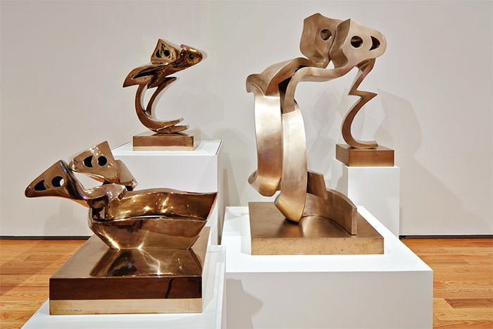"View of ""Parviz Tanavoli,"" 2015. Background, from left: Big Heech Lovers, 2007; Twisted Heech, 2007. Foreground, from left: Horizontal Heech Lovers, 2008; Standing Heech Lovers, 2007. Photo: Charles Mayer."