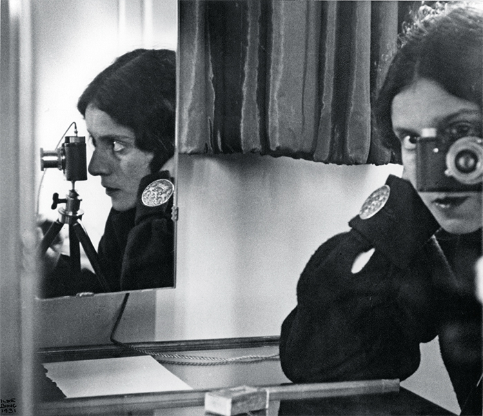 "*Ilse Bing, _Self-Portrait in Mirrors_, 1931*, gelatin silver print, 10 1/2 × 12""."