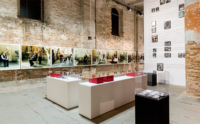 "View of ""All the World's Futures,"" 2015, Arsenale, Venice. Center: Samson Kambalu, Sanguinetti Breakout Area, 2015. On wall, left: Liisa Roberts, Petersburg Underground, 2015. Photo: Kate Lacey."