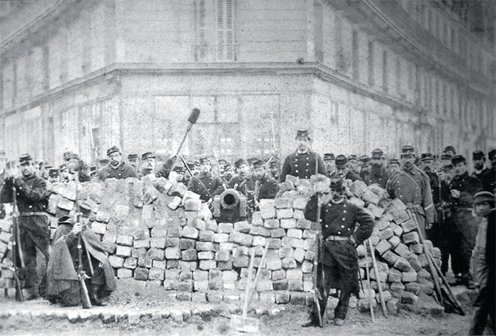 A barricade during the Paris Commune, boulevard Voltaire and boulevard Richard-Lenoir, 1871. Photo: Bruno Braquehais/BHVP/Roger-Viollet.