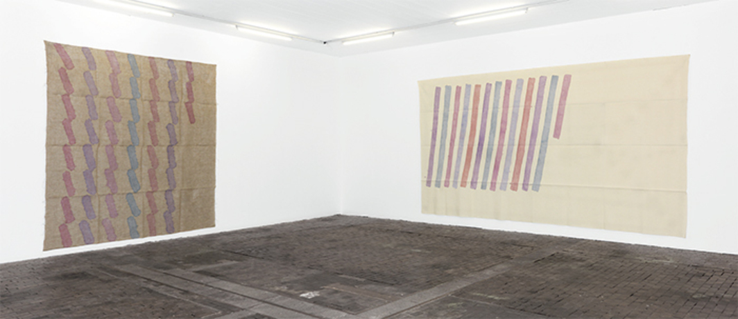 "View of ""Giorgio Griffa: A Retrospective 1968–2014,"" 2015. From left: Sei colori (Six Colors), 1977; Obliquo (Diagonal), 1976. Photo: Annik Wetter. All works by Giorgio Griffa © Artists Rights Society (ARS), New York/SIAE, Rome."
