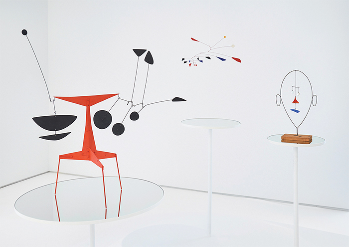 "View of ""Alexander Calder,"" 2015. From left: Red T with Black Flags, 1946; Untitled, ca. 1956; Untitled, 1941.
