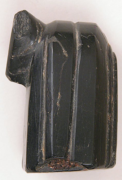 "*Chess piece, ca. eighth–tenth century CE*, jet, 2 × 1 3/8 × 1 3/8""."