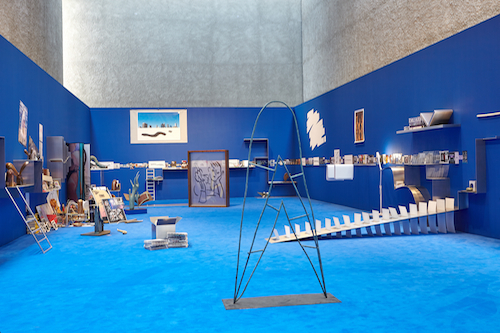 Camille Henrot, The Pale Fox, 2014, aluminium, bronze, prints, drawings, audio, found objects. Installation view, 2015.