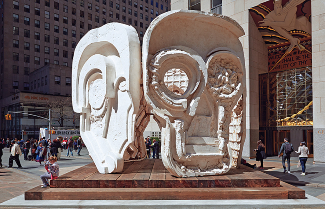 Thomas Houseago, Masks (Pentagon), 2015, Tuf-Cal, hemp, iron rebar, steel, redwood. Installation view, Rockefeller Center, New York.