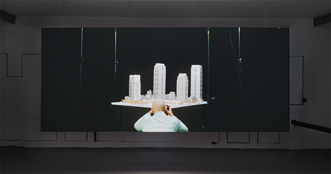 Amie Siegel, The Architects, 2014, HD video, color, sound, 30 minutes. Installation view. Photo: Miguel de Guzman.