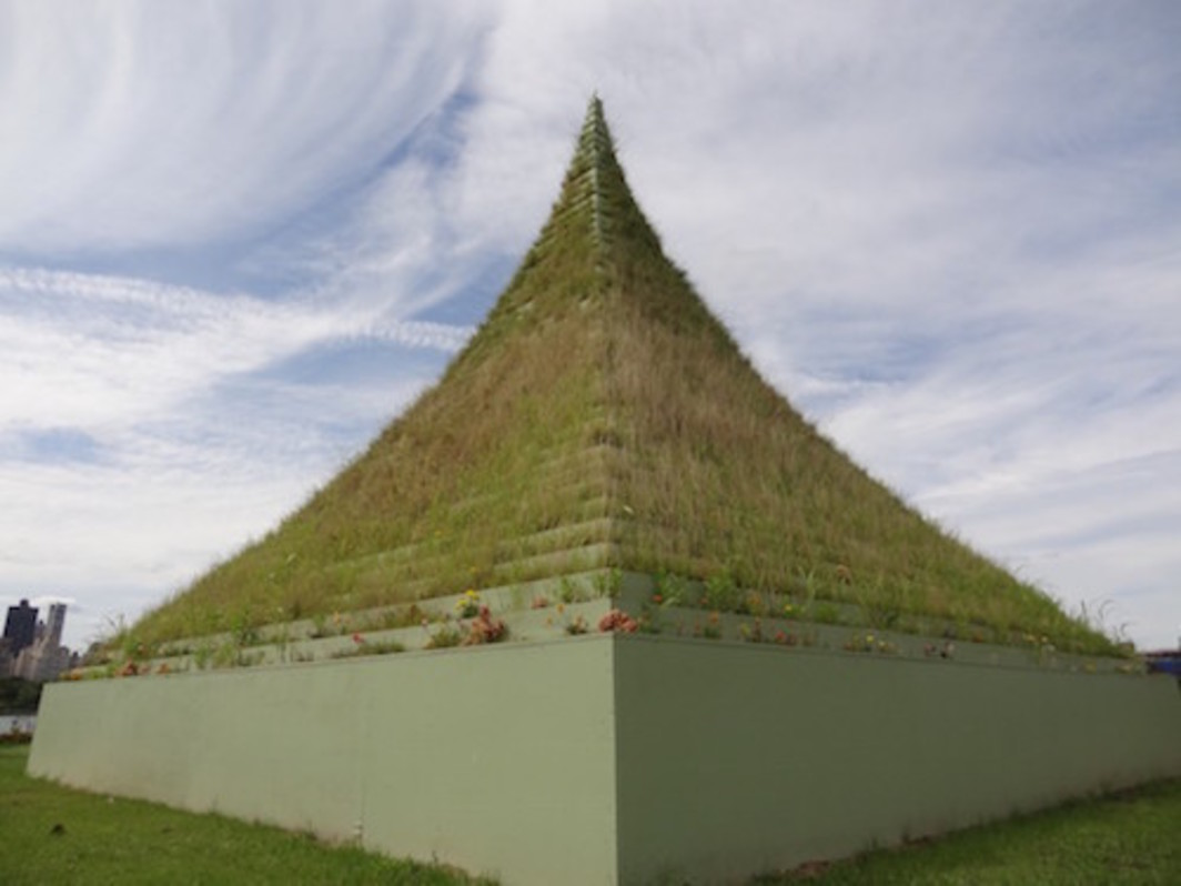 Agnes Denes, The Living Pyramid, 2015, flowers, grass, soil, wood, paint, 30 x 30 x 30'.