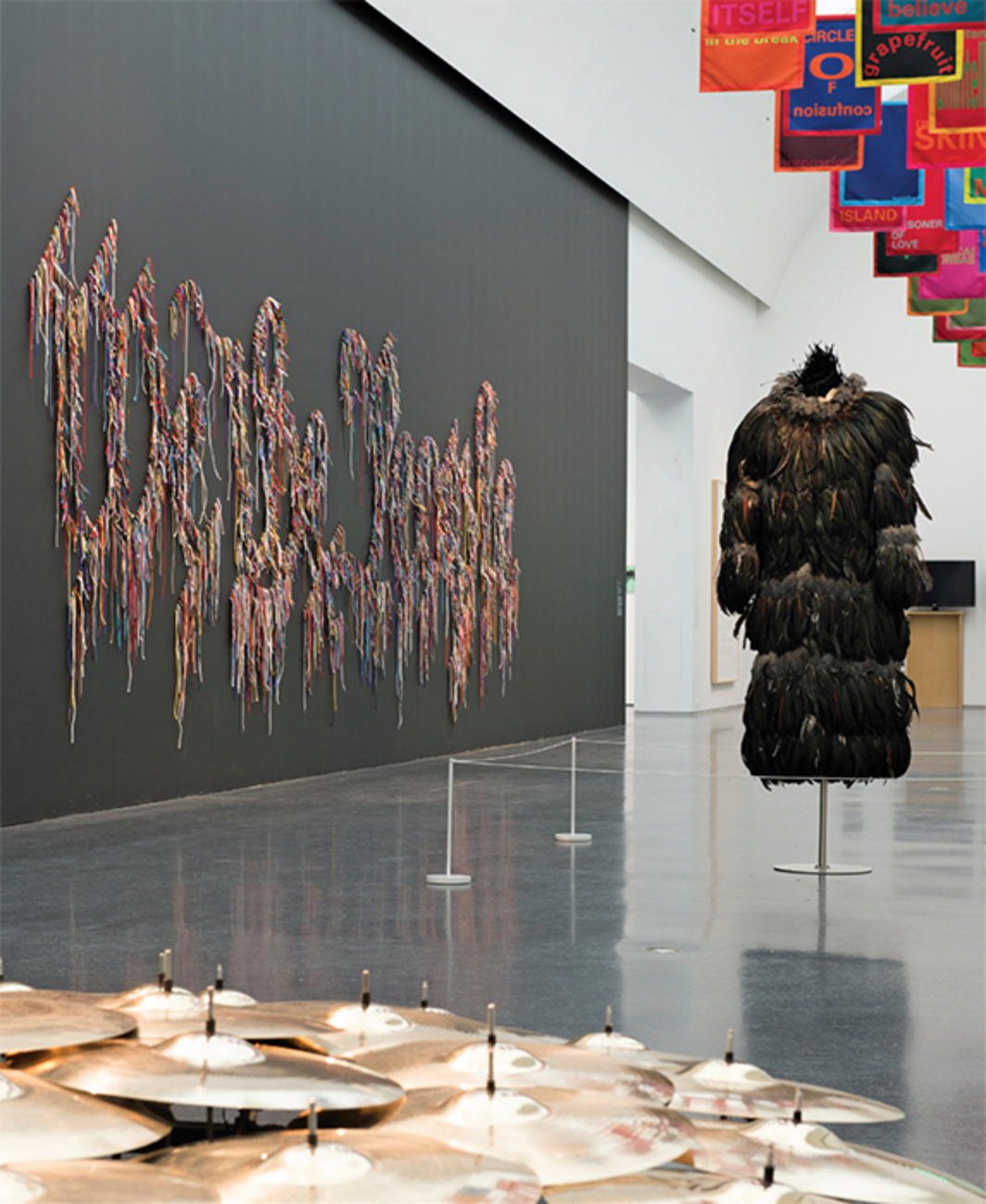 "View of ""The Freedom Principle: Experiments in Art and Music, 1965 to Now,"" 2015. Clockwise, from left: Nari Ward, We the People, 2011; Renée Green, Space Poem #3 (Media Bicho), 2012; Sanford Biggers, Ghetto Bird Tunic, 2006; Terry Adkins, Native Son (Circus), 2006/2015. Photo: Nathan Keay."
