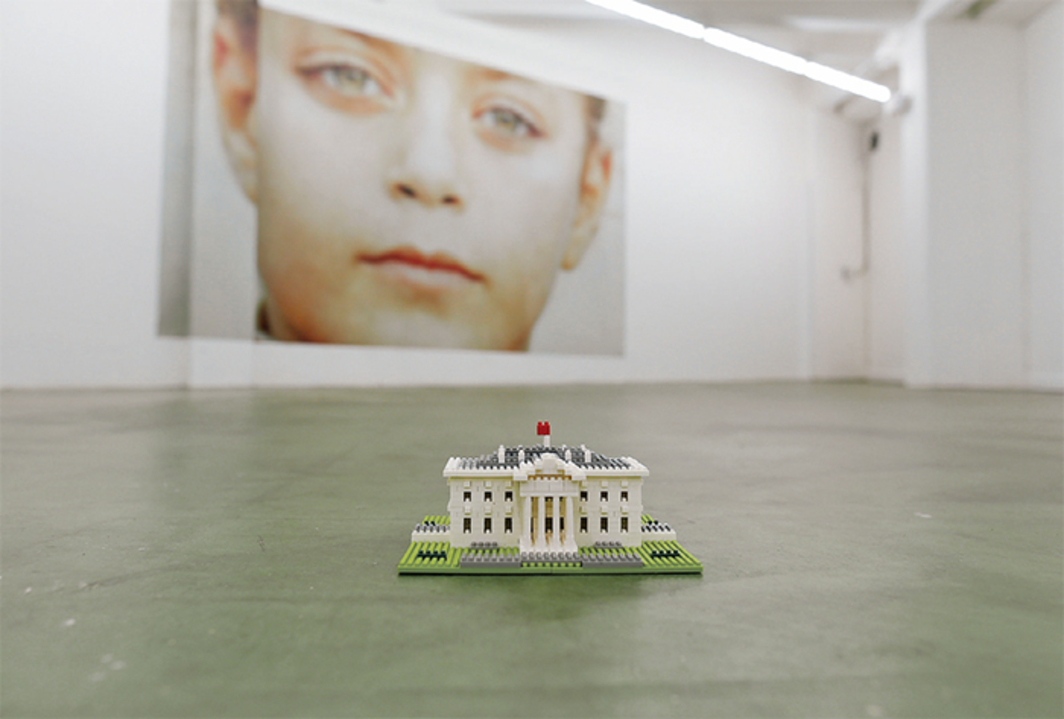 "View of ""Emily Jones: Orange House Action Clinic,"" 2015, S1, Portland, OR. Foreground: Nanoblock White House,