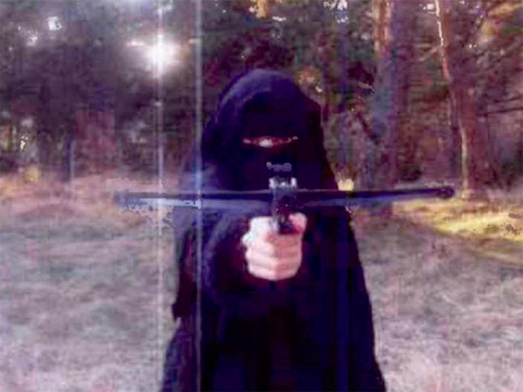 Photograph released in 2015 showing a  veiled figure believed to be Hayat Boumeddiene at a guerrilla training camp, Cantal, France, ca. 2010.