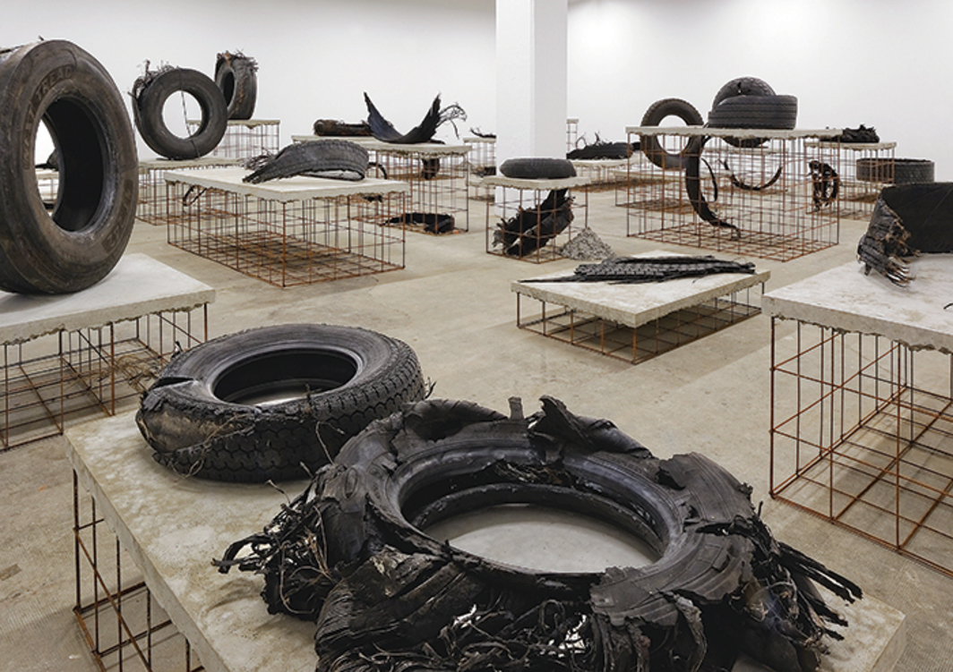 Mike Nelson, A7 (Route du soleil), 2015, tires, iron, concrete. Installation view, La Sucrière. Photo: Blaise Adilon.