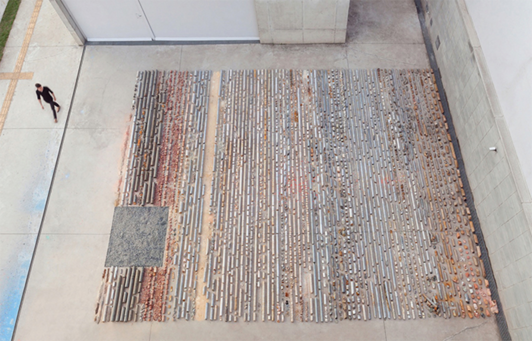 "Daniel de Paula, Testemunho, 2015, rock, soil, 8"" × 23' × 29'. Installation view. Photo: Filipe Berndt."