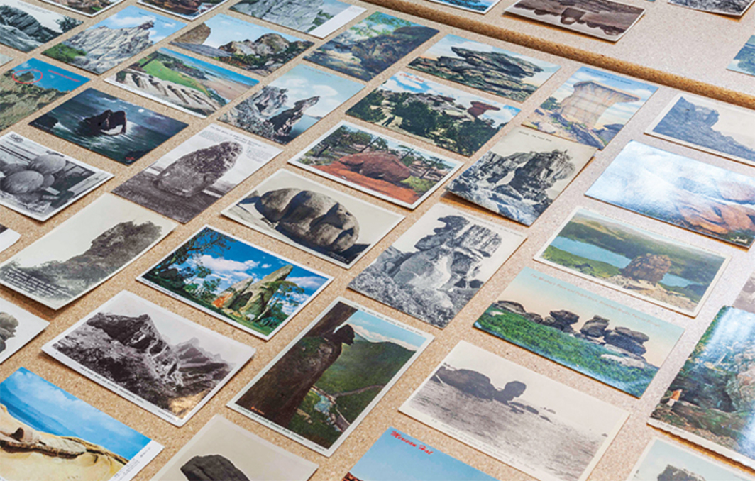 "Vintage postcards on view in ""Museum of Stones,"" 2015, Noguchi Museum, New York. Photo: Elizabeth Felicella."