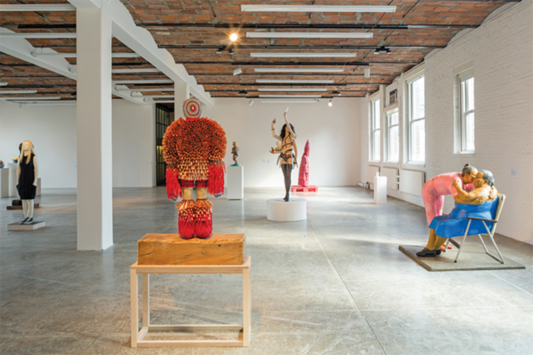 View of Greater New York, 2015–16. From left: Judith Shea, Easy Does It, 2014; Jeffrey Gibson, Burn for You, 2014; Red Grooms, Mr. Universe, 1990; Mary Beth Edelson, Kali Bobbit, 1994; Ignacio Gonzalez-Lang, Kueens, 2009; John Ahearn, Maria and Her Mother, 1987. Photo: Pablo Enriquez.