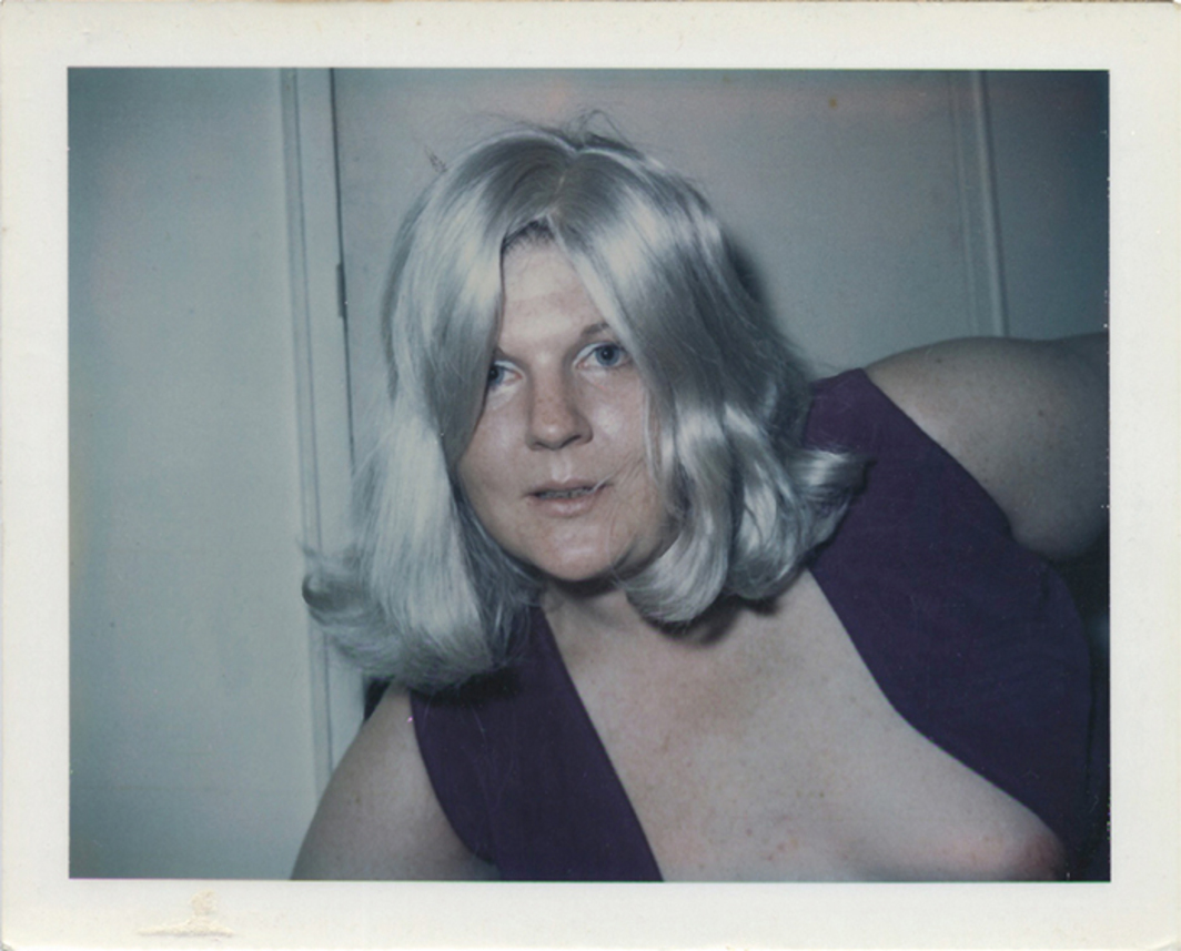"Brigid Berlin, Untitled (Self-Portrait with Wig II), ca. 1971–73, Polaroid, 3 3/8 × 4 1/4""."