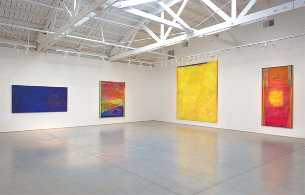 "View of ""Frank Bowling,"" 2015. From left: Schlesingerblue, 1968; Dragon Overhand for Verity, 2013; Mel Edwards Decides, 1968; Mother's House Dot Dot Com, 1966–99."