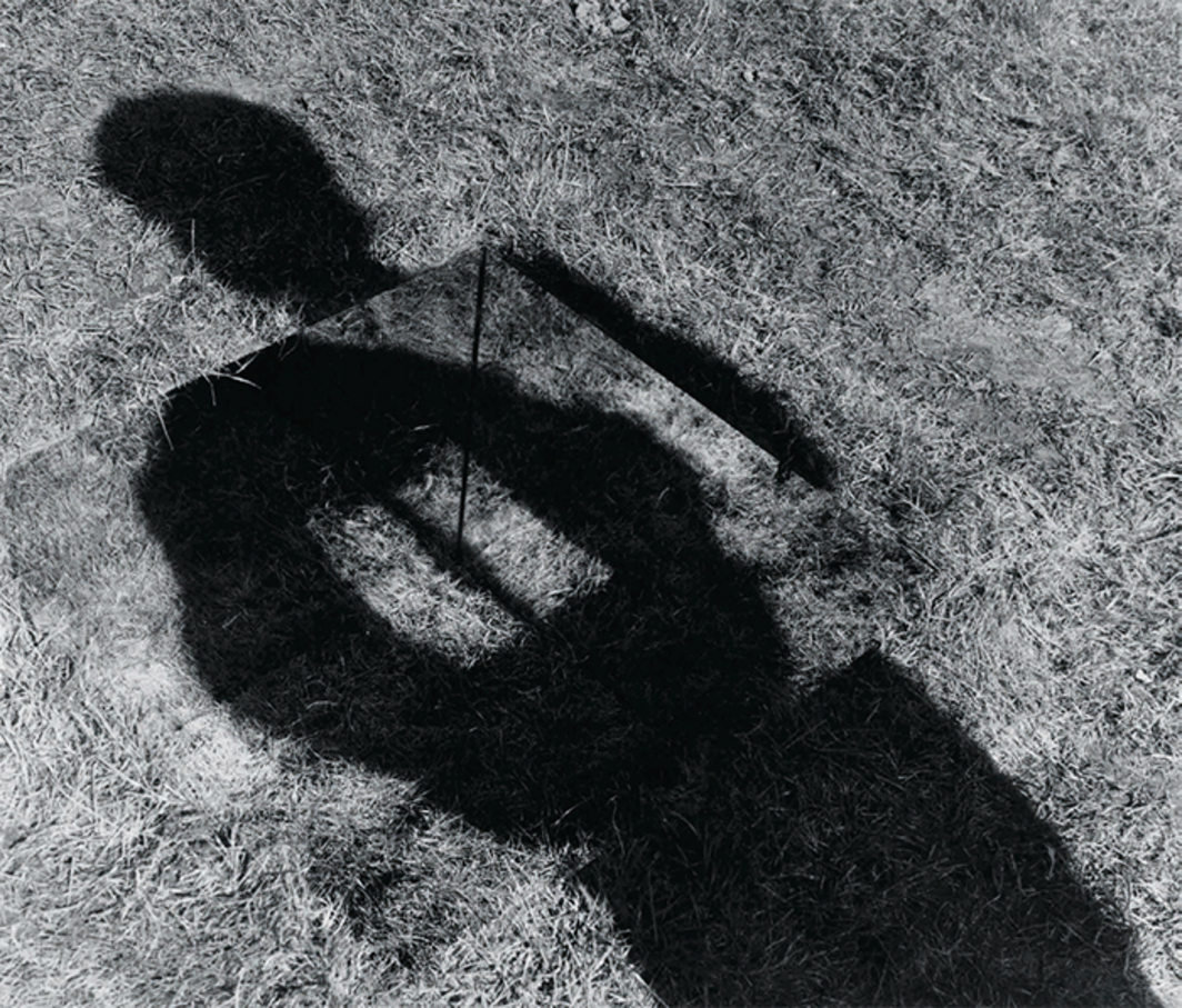 "Keith Arnatt, Invisible Hole Revealed by the Shadow of the Artist, 1968, gelatin silver print, 24 × 29 3/4"". From ""Conceptual Art in Britain: 1964–1979."" © Artists Rights Society (ARS) New York, NY/DACS, London."