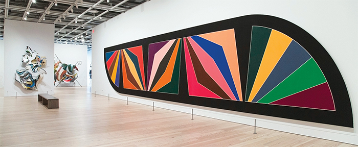 "View of ""Frank Stella: A Retrospective,"" 2015–16. From left: The Grand Armada (IRS-6, 1X), 1989; K.81 combo (K.37 and K.43) large size, 2009; Damascus Gate (Stretch Variation III), 1970. Photo: Chandra Glick. © Frank Stella/Artist Rights Society (ARS), New York."