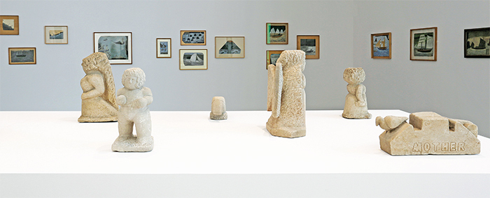 "View of ""The Shadow of the Avant-Garde: Rousseau and the Forgotten Masters,"" 2015–16. Foreground: Works by William Edmondson. Background: Works by Alfred Wallis. Photo: Jens Nober."