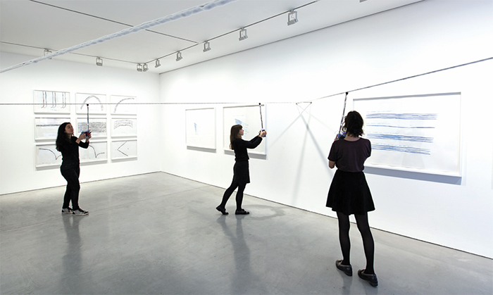 "View of ""Christine Sun Kim,"" 2015–16. Foreground: Viewers interacting with Game of Skill 1.0, 2015. Photo: Robin Reeve."