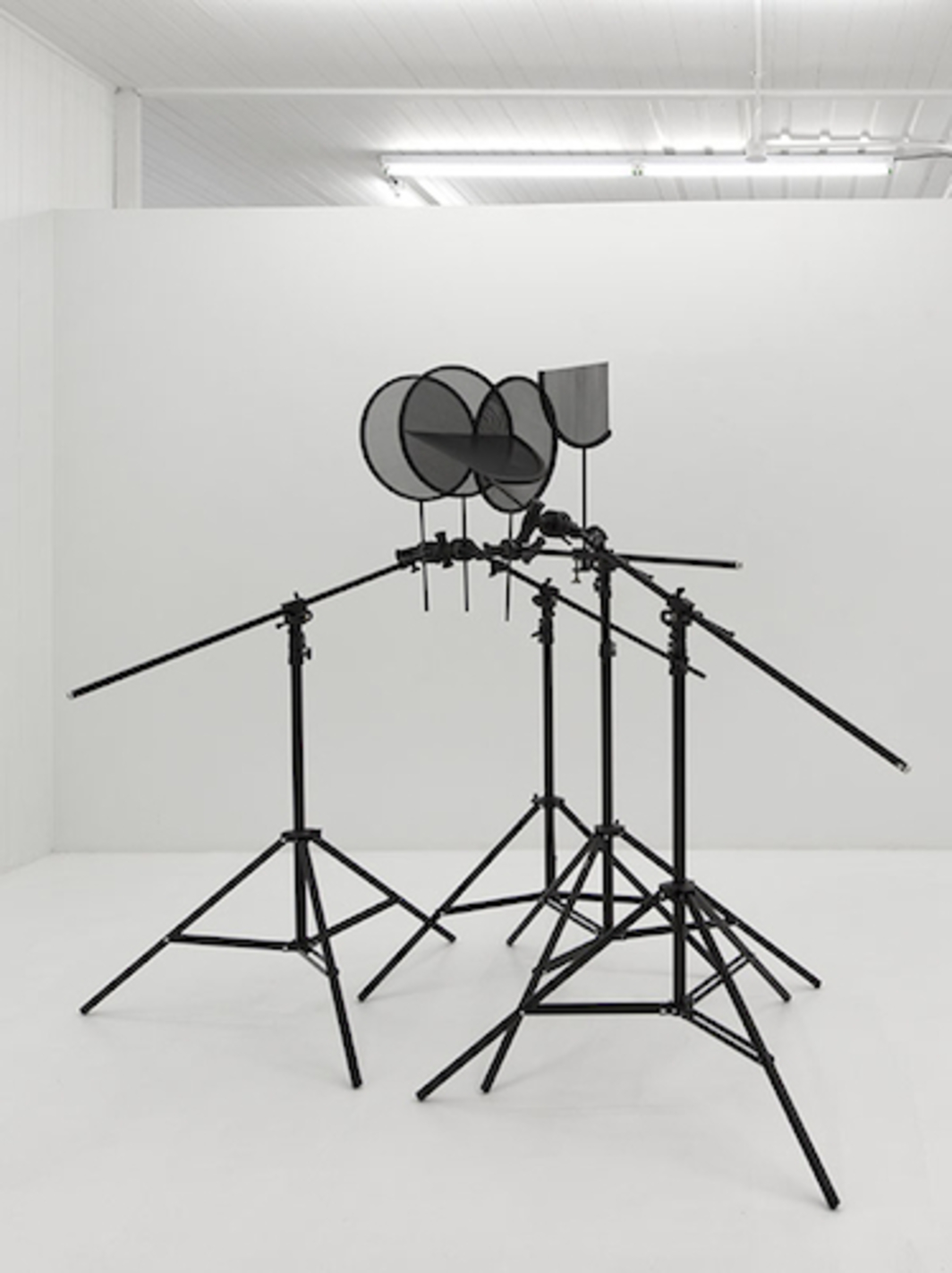 "Mike Bray, Day for Night, 2016, light stands, wood, steel, aluminum, 78 x 96 x 78""."