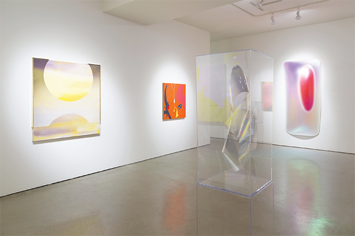 "View of ""Atmospheric Abstraction,"" 2015–16. From left: Mara De Luca, RAMONA 1 (SV), 2015; Heather Gwen Martin, Cave Song, 2015; Larry Bell, 3D VD 1.30.15D, 2015; Gisela Colón, Mega Rectanglopoid Glo-Pod (Iridescent Red), 2014. Photo: Philipp Scholz Rittermann."