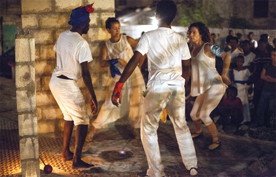 Dasha Chapman, Yonel Charles, Jean-Sebastien Duvilaire, and Ann Mazzocca, Activating Petwo's Kinesthetic Imagination: Dancing Revolution and Forging Lakou in the Gran Rue, 2015. Performance view, Lakou Twoket, Port-au-Prince, Haiti, December 19, 2015. From the 4th Ghetto Biennale. Photo: Lazaros.