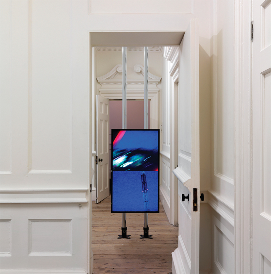 "*Hilary Lloyd, _Crane_, 2010*, 42"" JVC LCD monitor, Western Digital HD Media Player, Unicol Twin Column mount; HD video (color, sound, indefinite duration). Installation view, Raven Row, London, 2011. Photo: Marcus J. Leith."