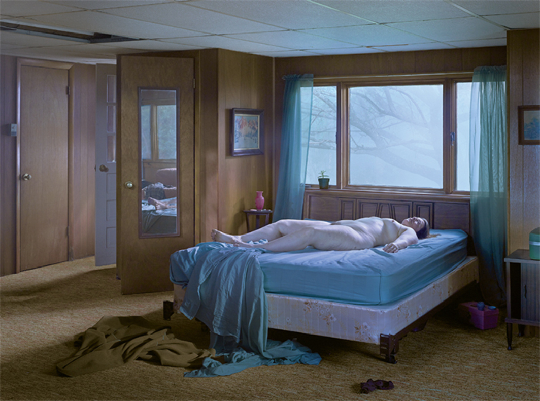 "Gregory Crewdson, Reclining Woman on Bed, 2013, ink-jet print, 45 × 57 1/2""."