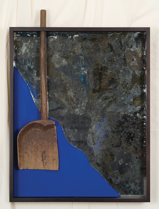 "Edgar Arceneaux, Chocolate Figures. One., 2016, handmade wooden shovel, chocolate, acrylic on muslin, and mirror on wood panel, wooden frame, 48 × 35 × 4 3/4""."