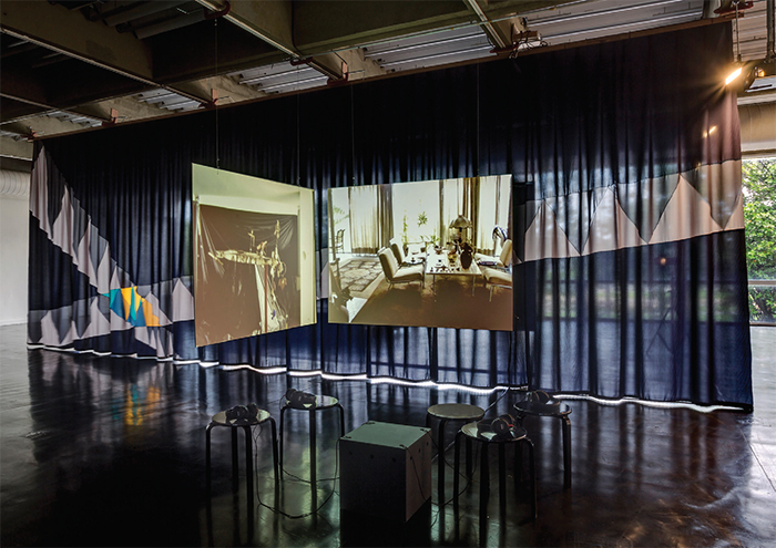 "View of ""Laercio Redondo,"" 2015–16. Backdrop: Desvios (Detour) (detail), 2015. On screens: A casa de vidro (The Glass House), 1998/2008. Photo: Sergio Araujo."
