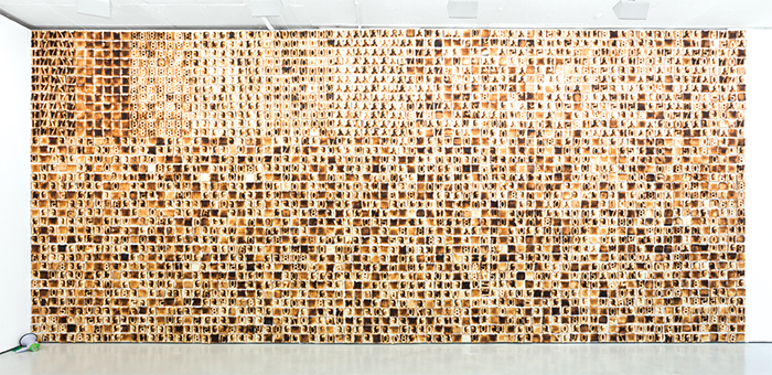 "Yonamine, Pão nosso de cada Dia (Our Daily Bread), 2016, toasted bread, nails, 11' 5 3/4"" × 26' 3""."